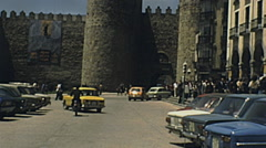 Avila 1977: people walking in front of the castle Stock Footage