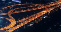 Cars moving on highway road at night. Traffic lights of futuristic city  - stock footage