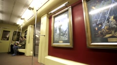 Subway train with a collection of masterpieces on the theme of World War II. Stock Footage