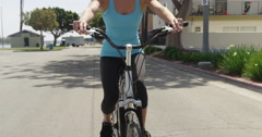 Happy young woman riding bike on path Stock Footage