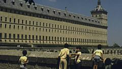 Escoral, Spain 1977: children playing in front of the palace Stock Footage