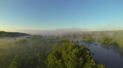 Mysterious landscape with wood , river and  fog. Aerial - stock footage