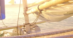 Warm sun light on construction details of small wooden sail boat yacht at summer - stock footage