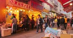 People passing small street with many local shops located on its sides Stock Footage