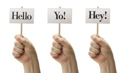 Three Signs In Fists Saying Hello, Yo! and Hey! Stock Photos