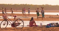 Burmese citizens of local village bathing and washing clothes in Irrawaddy river Stock Footage