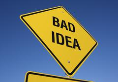 Yellow Bad Idea Road Sign Against A Deep Blue Sky with Clipping Path. - stock photo