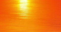 Sunlight reflecting in water surface at sunset Stock Footage