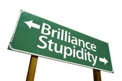 Brilliance and Stupidity Green Road Sign Stock Photos