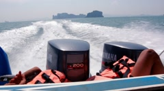 Boy sleeps next to outboard motors of a speed boat in Ao Nang, Thailand Stock Footage