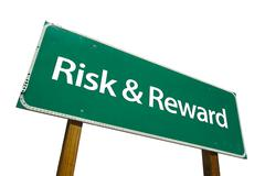 Risk and Reward Green Road Sign - stock photo