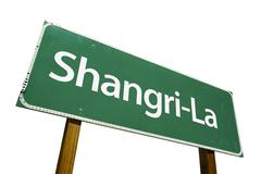 Shangri-La Green Road Sign Isolated on a White Background with Clipping Path. Stock Photos