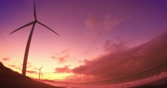 Amazing sunset sky with wind mill turbine rotating and generating green energy Stock Footage