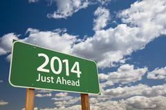 2014 Just Ahead Green Road Sign Over Dramatic Clouds and Sky. - stock photo
