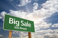 Big Sale, Just Ahead Green Road Sign Over Dramatic Sky, Clouds and Sunburst. - stock photo