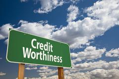 Credit Worthiness Green Road Sign Over Clouds and Sky. Stock Photos