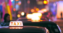 Blurred background of passenger entering inside taxi cab. Taxi sign Stock Footage