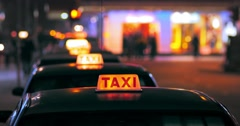 Driver of taxi cab looking for customers on Hongkong street at night Stock Footage