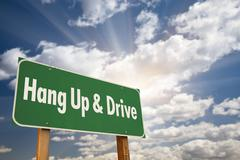 Hang Up and Drive Green Road Sign with Dramatic Sky, Clouds and Sun. - stock photo