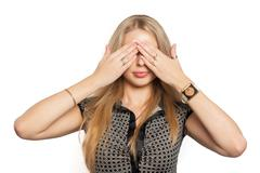 Stock Photo of Pretty woman in See No Evil gesture
