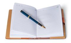 Fountain pen on top of the open notebook - stock photo