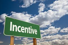 Incentive Green Road Sign Over Clouds and Sky. - stock photo