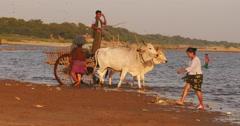 Burmese peasants on riverbank of Irrawaddy river in rural parts of Myanmar - stock footage