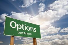 Options Green Road Sign Against Clouds and Sunburst. - stock photo