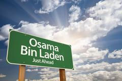 Osama Bin Laden Green Road Sign on Dramatic Blue Sky with Clouds. - stock photo