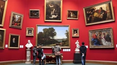 Visitors Are Watching Paintings In The Art Gallery Stock Footage