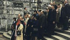 Lourdes 1977: group of pilgrims posing for a photo Stock Footage