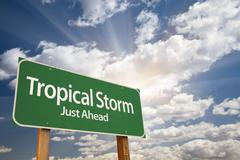 Tropical Storm Green Road Sign with Dramatic Clouds and Sky. Stock Photos