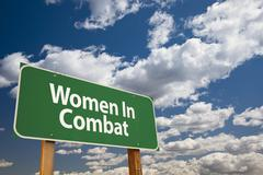 Women In Combat Green Road Sign Over Clouds and Sky. Stock Photos