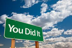 You Did It Green Road Sign with Sky - stock photo