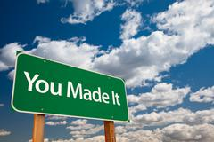 You Made It Green Road Sign with Sky - stock photo