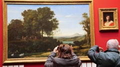 Visitors Observe And Photographing Paintings Smartphones Stock Footage
