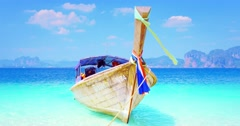 Wooden long tail tourist boat near Phuket tropical island at sunny summer day - stock footage