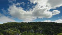 Time lapse of fast moving clouds over rocky forest in Sagada, Philippines Stock Footage