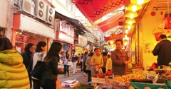 citizens of Hongkong in old market place at traditional quarter of city - stock footage