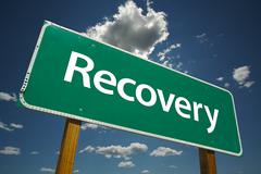 Recovery Green Road Sign with Dramatic Clouds and Sky. Stock Photos