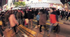 citizens of Hongkong crossing busy street at late evening in downtown. Big crowd - stock footage