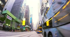 Time lapse video of city transportation in Hongkong. Modern buildings and buses Stock Footage