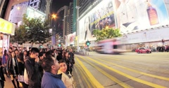 people crossing busy street in Hongkong downtown at night. Public transportation - stock footage