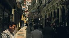 Sevilla 1977: people walking in the pedestrian zone Stock Footage