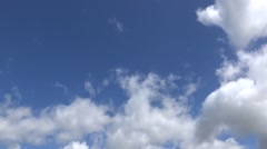 Time lapse of white fluffy clouds on a Blue Sky - stock footage