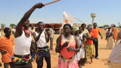 WAVING SOUTH SUDAN FLAG DURING POLITICAL RALLY IN SOUTH SUDAN, AFRICA Stock Footage