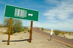 Abstract Barcode Green Road Sign Image. Road leading to the desert. - stock photo