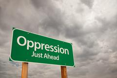 Oppression Just Ahead Green Road Sign with Dramatic Storm Clouds and Sky. - stock photo