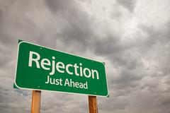 Rejection Just Ahead Green Road Sign with Dramatic Storm Clouds and Sky. - stock photo