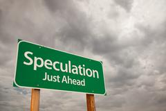 Speculation Just Ahead Green Road Sign with Dramatic Storm Clouds and Sky. Stock Photos